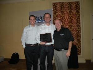 Travis pictured here with Pro Image Sports (name of Hawkes retail entity) CEO Dave Riley and Sports Fan Corp VP & COO Brandon Miner has been a three-time winner of Pro Image Sports Franchisee of the Year.